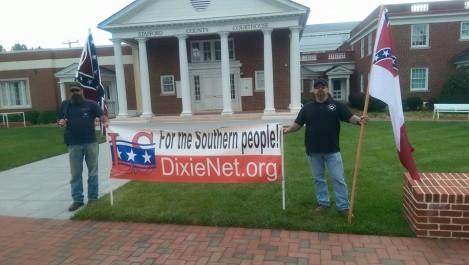 """A couple supporters having a """"rally"""" in support of the Confederate Battle Flag."""